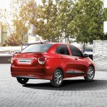 Hyundai Grand i10 Sedan (Xcent) rear three quarter press shot