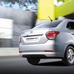 Hyundai Grand i10 Sedan (Xcent) rear three quarter right press shot
