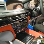 BMW X5M carbon center console snapped India