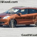 2016 Suzuki Baleno (Maruti YRA) front three quarter orange spotted in the wild