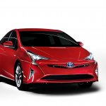 2016 Toyota Prius front three quarter view red North American specification official image