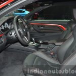 BMW M4 in Frozen Red metallic front seats at iAA 2015