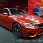 BMW M4 in Frozen Red metallic front three quarter left at iAA 2015
