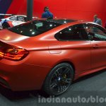 BMW M4 in Frozen Red metallic rear three quarters at iAA 2015