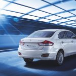Maruti Ciaz SHVS rear three quarter press image