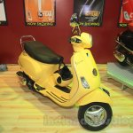Vespa VX front three quarter yellow at Nepal Auto Show 2015