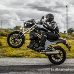 Mahindra Mojo wheelie side wallpaper