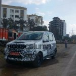 New Mahindra Canto Quanto facelift front quarter camouflaged spyshot