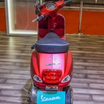 Vespa SXL 150 red rear at Auto Expo 2016