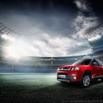 Maruti Vitara Brezza red front three quarter press image
