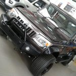 Modified Mahindra Bolero front spied at a dealership