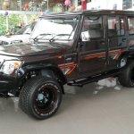 Modified Mahindra Bolero front three quarter spied at a dealership