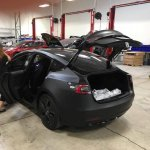 Tesla Model 3 rea rthree quarters spy shot