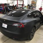 Tesla Model 3 rear three quarters right side spy shot