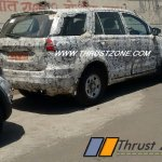Base and top-end variants of Tata Hexa rear three quarter spied together