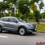 Nissan Kicks official image front three quarters right side driving shot