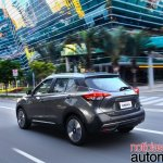 Nissan Kicks official image rear three quarters left side urban driving shot
