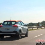 Nissan Kicks rear three quarters driving shot