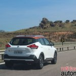 Nissan Kicks rear three quarters in motion