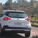 Nissan Kicks rear three quarters left side in motion