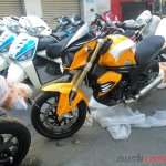 Mahindra Mojo Sunburst Yellow side at dealership