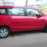 Proton Ertiga red side photographed