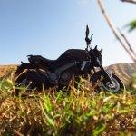Bajaj Dominar 400 Twilight Plum with grass
