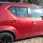 Maruti Ignis Red rear three quarters at dealer stockyard