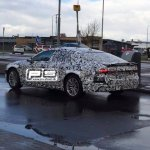 2018 Audi A7 rear three quarters left side spy shot
