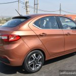 Tata Tigor petrol rear three quarter highway First Drive Review