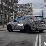 2018 BMW X5 rear three quarters left side spy shot