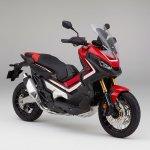Honda X-ADV Victory Red front three quarter studio