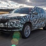 Skoda Karoq front three quarters in motion camouflaged