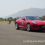 Jaguar F-Type red front three quarters in motion