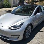 Tesla Model 3 front three quarters left side spy shot