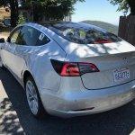 Tesla Model 3 rear three quarters left side spy shot