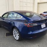 Tesla Model 3 blue rear three quarters spy shot