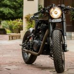 Royal Enfield Thunderbird 500 cafe racer by Rajputana Customs front three quarter right