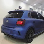VW Polo with sports body kit and matte blue wrap rear quarter