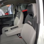 Mahindra KUV100 NXT white accessorised front seats