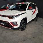 Mahindra KUV100 NXT white accessorised front three quarters