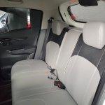 Mahindra KUV100 NXT white accessorised rear seats