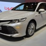 2018 Toyota Camry Hybrid front three quarters left side at 2017 Dubai Motor Show