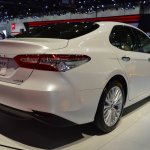 2018 Toyota Camry Hybrid rear three quarters right side at 2017 Dubai Motor Show