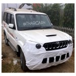 Mahindra Scorpio facelift spied with low camouflage