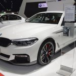 2017 BMW 5 Series with BMW M Performance accessories front three quarters left side at 2017 Thai Motor Expo