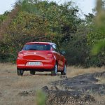 2018 Maruti Swift test drive review rear three quarters far