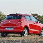 2018 Maruti Swift test drive review rear three quarters view