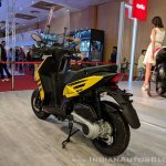 Aprilia Storm Yellow with accessories rear left quarter at 2018 Auto Expo