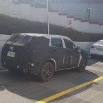 Alleged Kia SP prototype rear three quarters spy shot